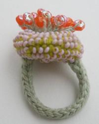 AnnaMona Ring.  Glass beads, merino wool, crocheted and knitted.