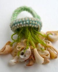 AnnaMona Ring. Shells, glass beads, merino wool, crocheted and knitted.