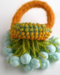 AnnaMona, ring.  Glass beads, merino wool, crocheted and knitted.