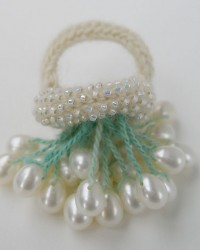 AnnaMona Ring.  Pearls, glass beads, merino wool, crocheted and knitted.