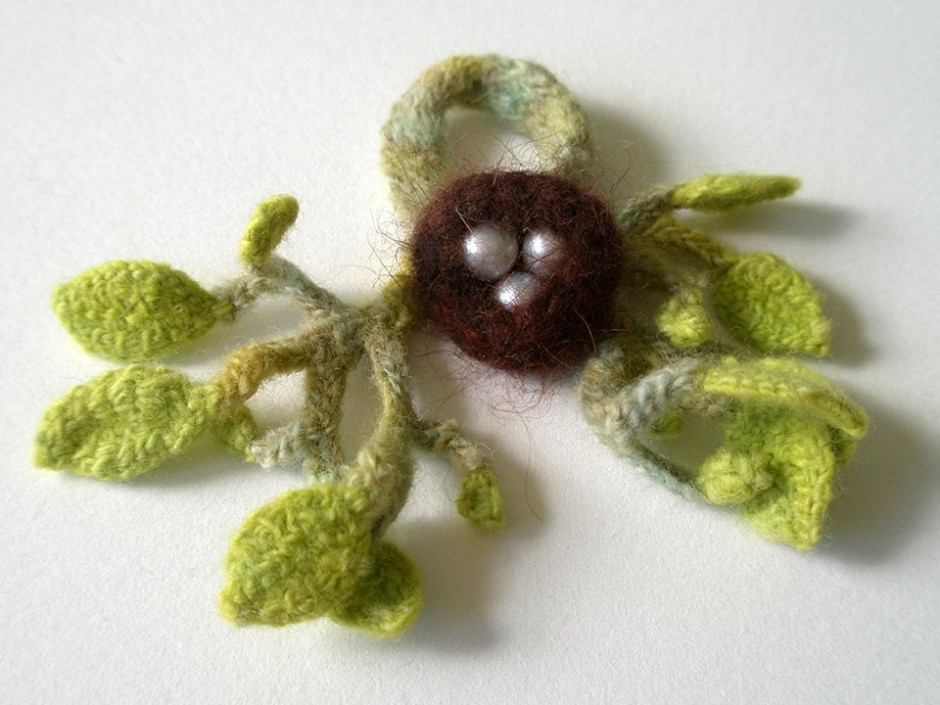 Dark Nest, ring.  Pearls, hand-dyed angora, merino wool, crocheted and knitted.