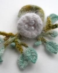 Nest, ring.  Pearls, merino wool, angora, crocheted and knitted.