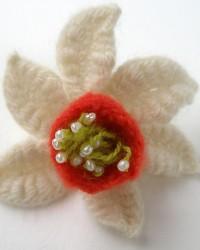 Daffodil ring.  Tiny fresh water pearls, merino wool.