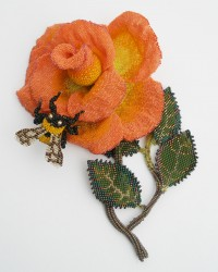 "Sunset Rose, Brooch.  Glass seed beads, wood, wire, nylon thread, sterling silver pin back.  Featured in Valerie Hector's book, ""The Art of BeadWork""."