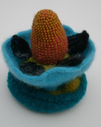 Jewelry Box.  Glass beads, wool, crocheted, knitted and fulled.