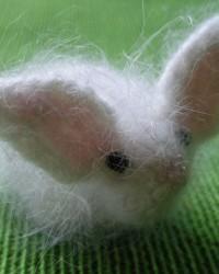 Bunny.  Glass beads, angora, mohair, knitting and crochet.