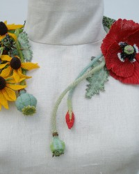 Summer Solstice, Necklace.  Glass seed beads, wood, wire, nylon thread, sterling silver pin back on Cicada.