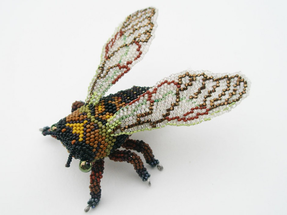 Cicada Brooch.  Glass seed beads, wood, wire, nylon thread, sterling silver pin back.