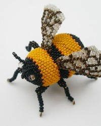 Bumble Bee, Brooch.  Glass seed beads, wood, wire, nylon thread, sterling silver pin back.
