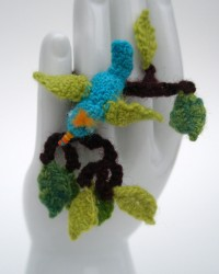 Blue bird in branches, ring.  Crocheted and knitted merino wool. Glass seed beads.