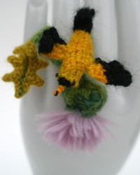 Goldfinch on Thistle ring.  Glass seed beads, merino wool, crocheted and knitted.  All original designs.